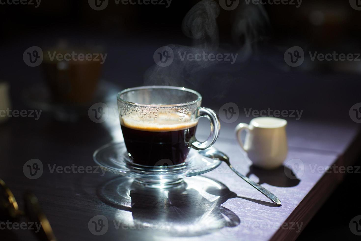 cup of hot coffee on the table photo