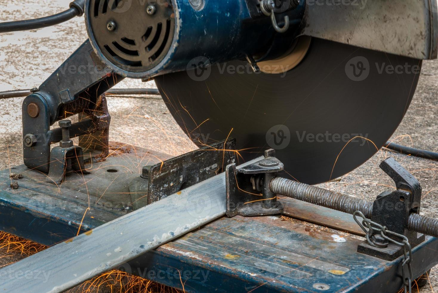 Cutting a triangle metal and steel with compound mitre saw photo