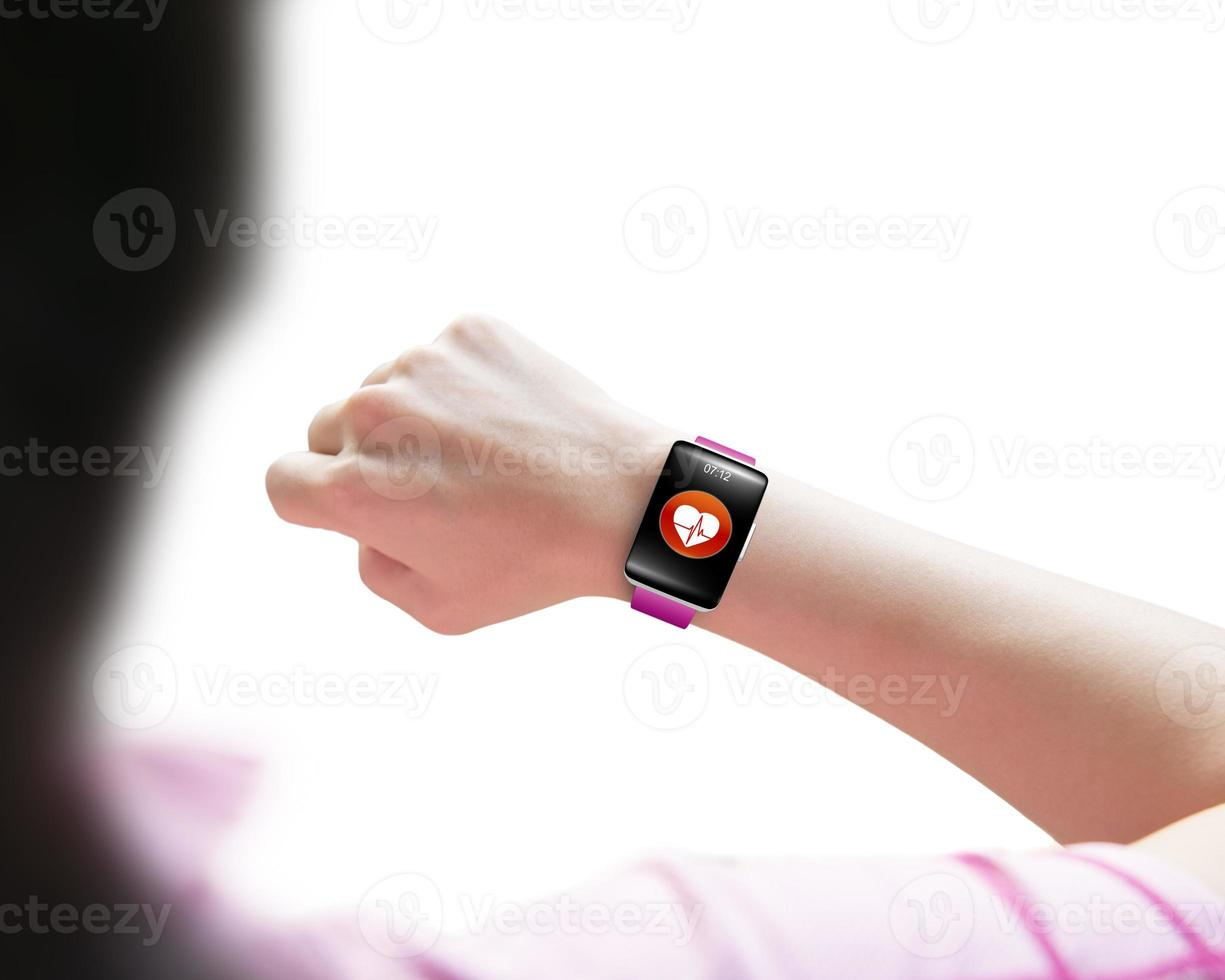 Sport woman looking at health sensor smart watch hand wearing photo