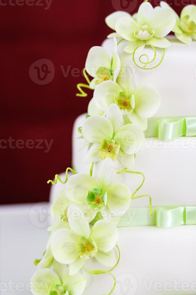 Wedding cake detail with orchid flowers photo