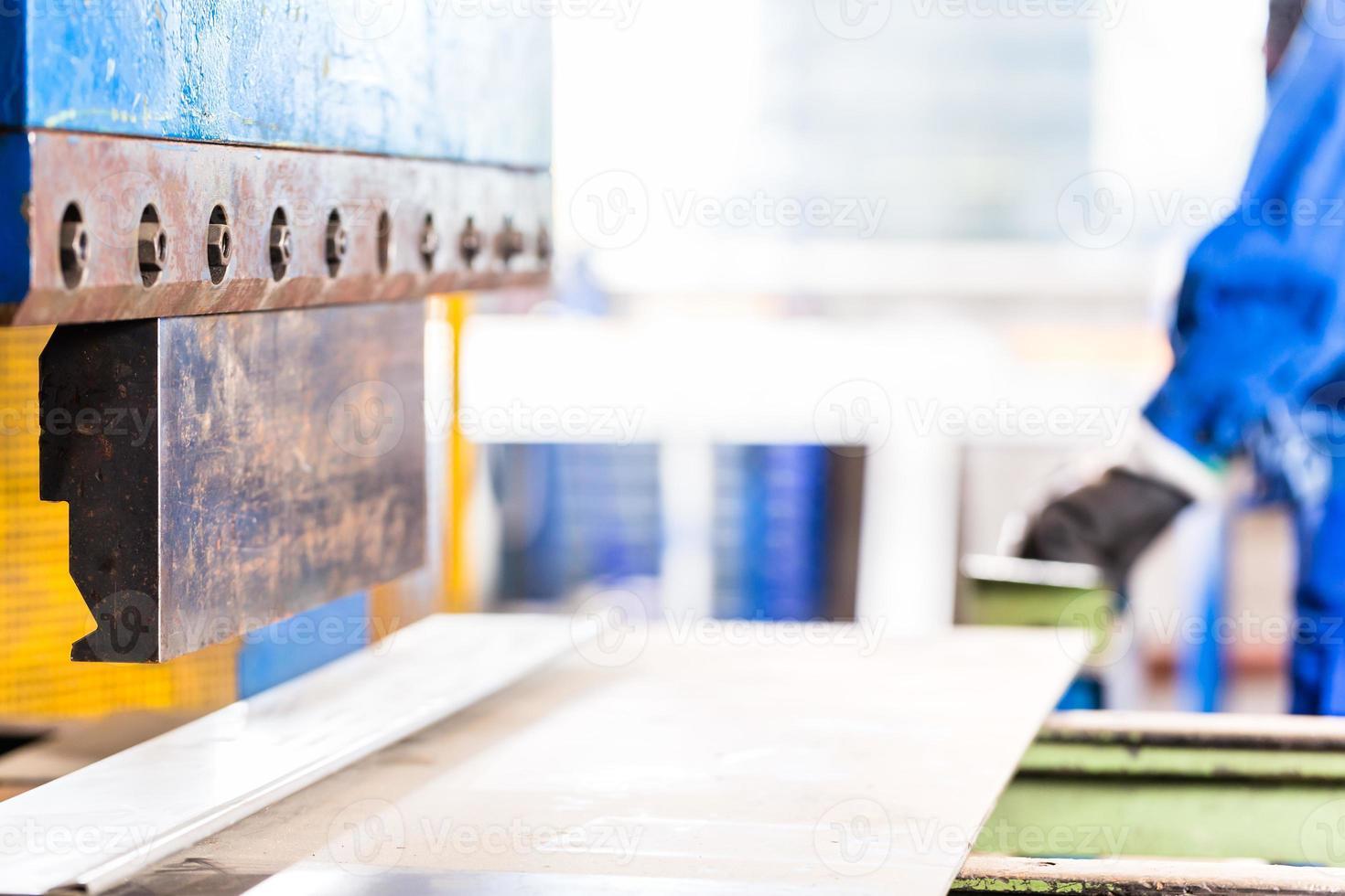 Craftsman using metal skip photo