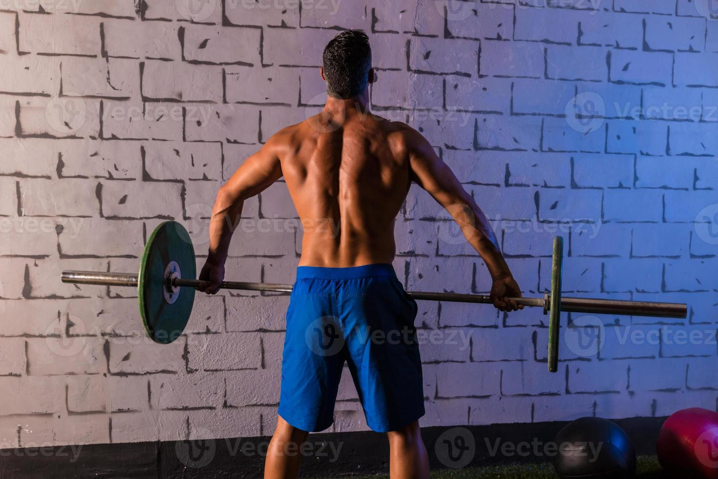 Barbell weight lifting man rear view workout gym photo