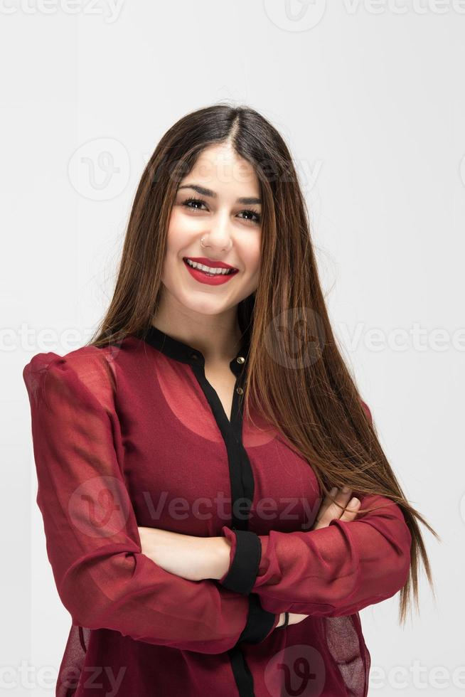 Positive elegant young female with smile and crossed arms photo