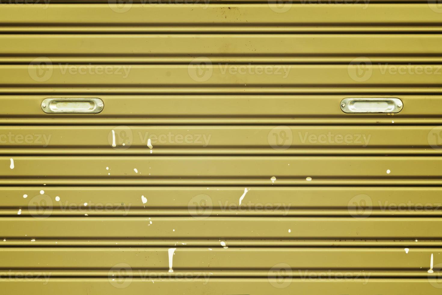 Dirty corrugated metal sheet slide door photo