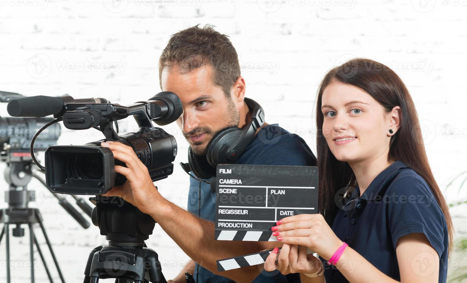 cameraman and a young woman with a movie camera photo