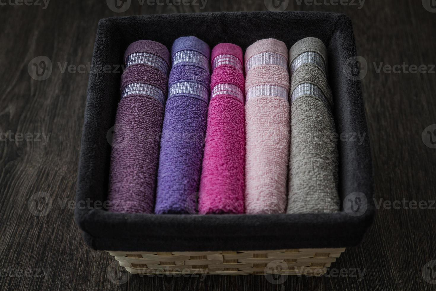 Colorful Towels in Wicker Basket photo