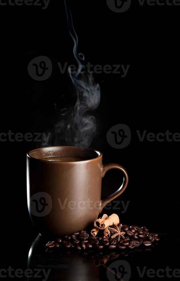 aromatic cup of coffee with smoke and beans photo