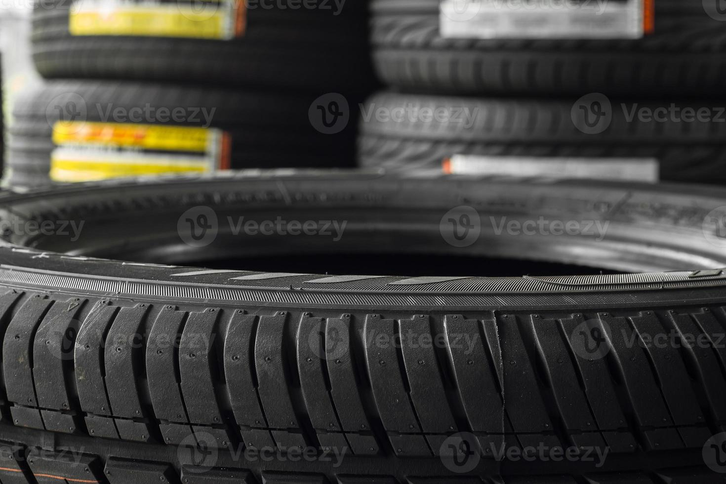 Car tires in shelf tire storehouse. photo