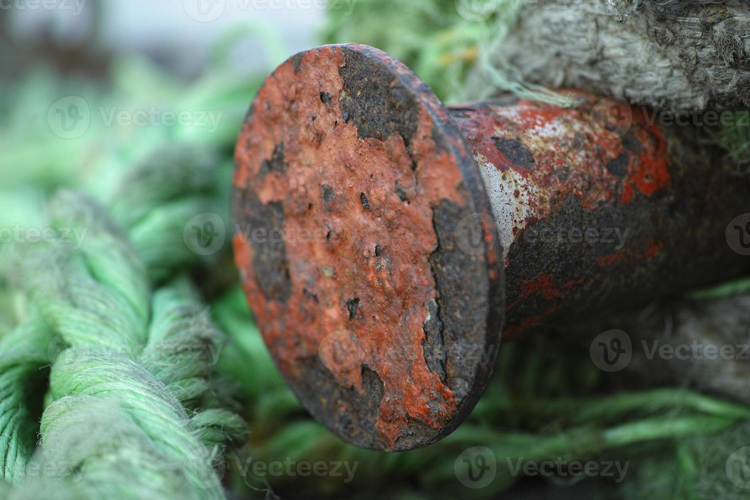 green rope and rusty metal photo