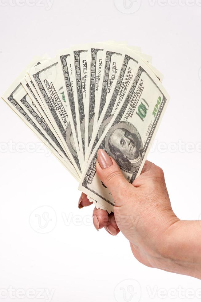 Hand holding american dollar bills. Isolated on a white backgrou photo