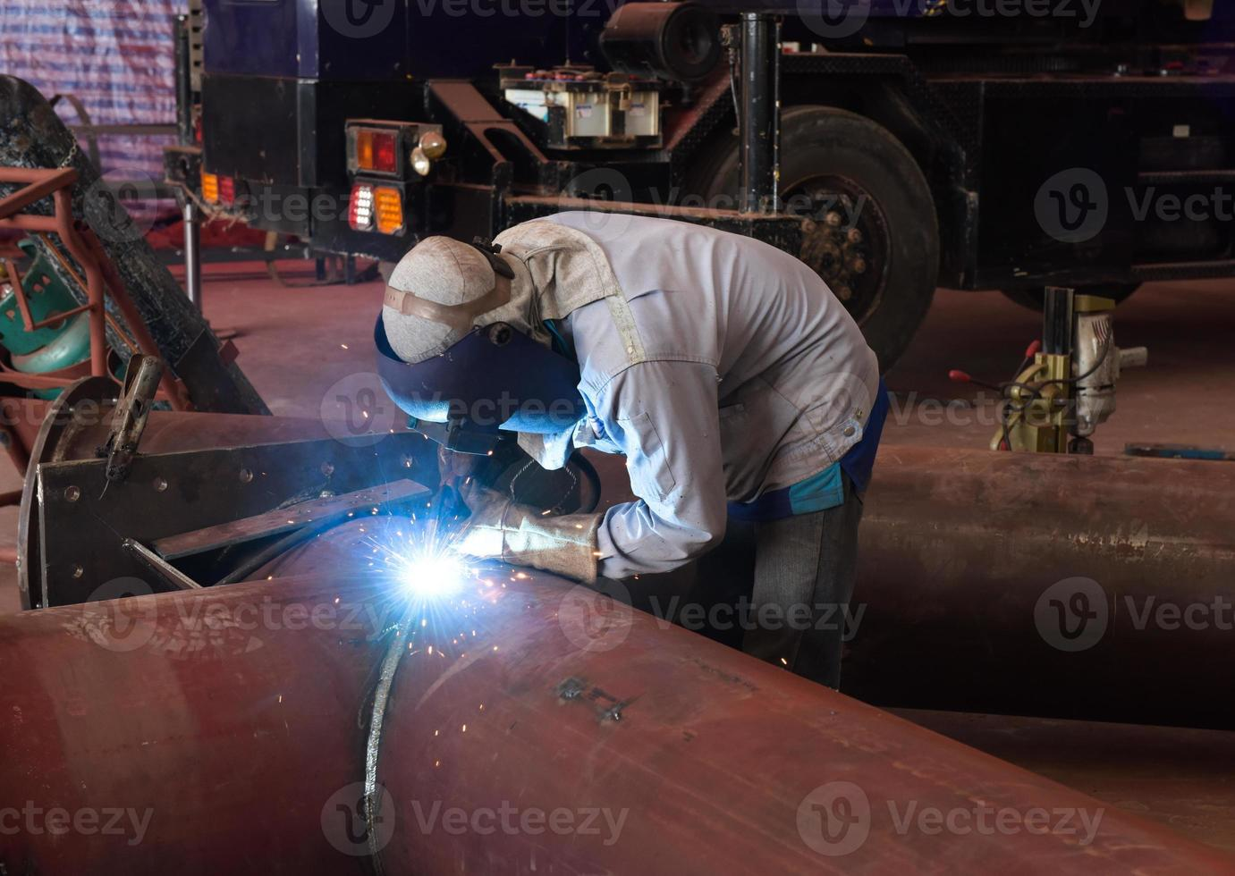 Welder on the pipe photo
