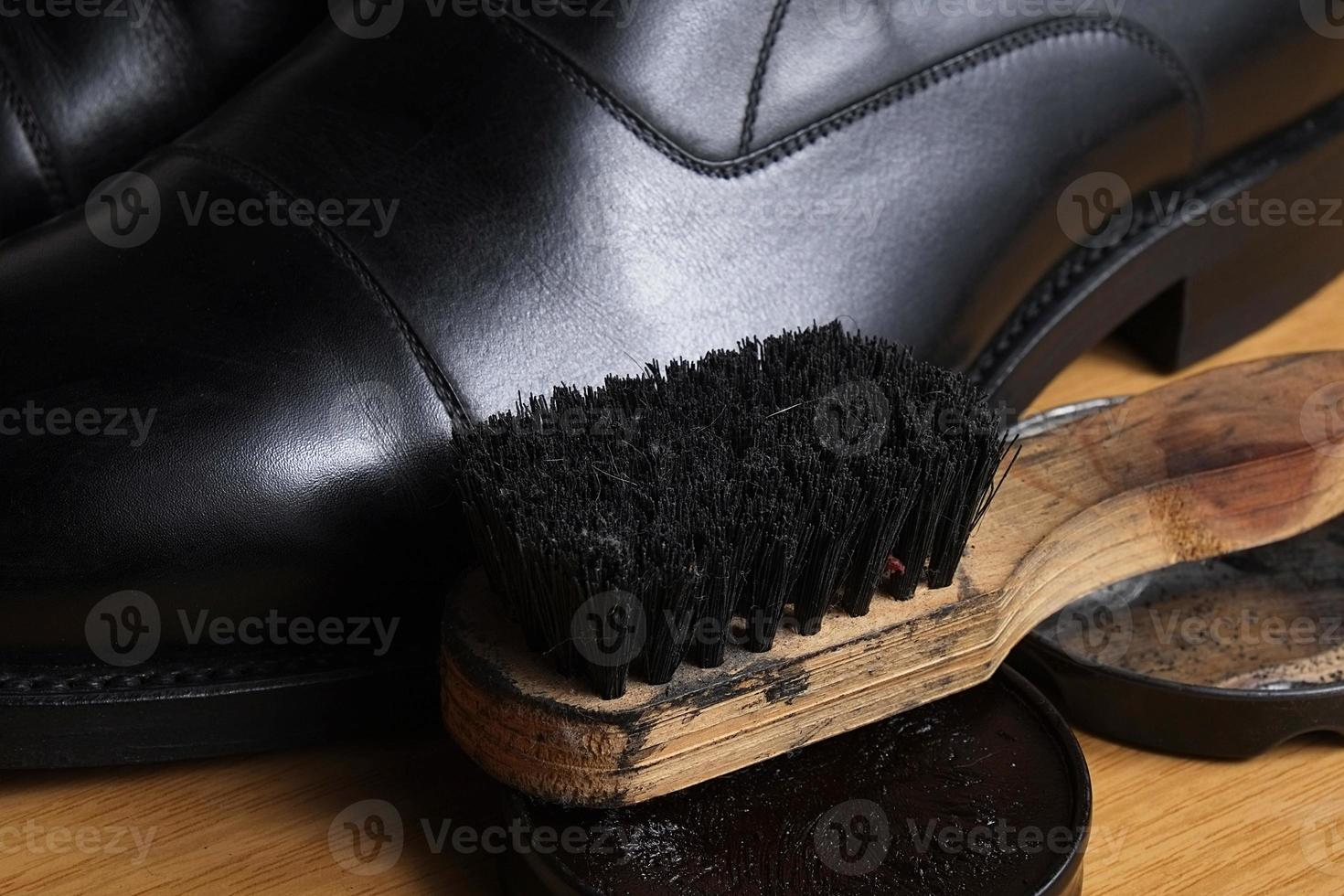 Black leather classic shoes with polishing cream and brush photo