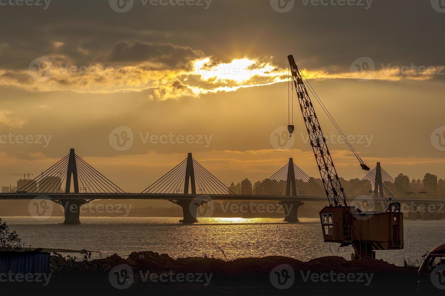 Cranes and bridge photo