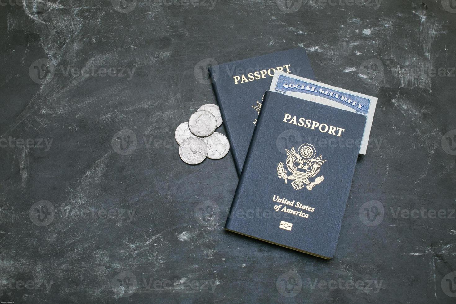 Two US passports and social security card on black background photo