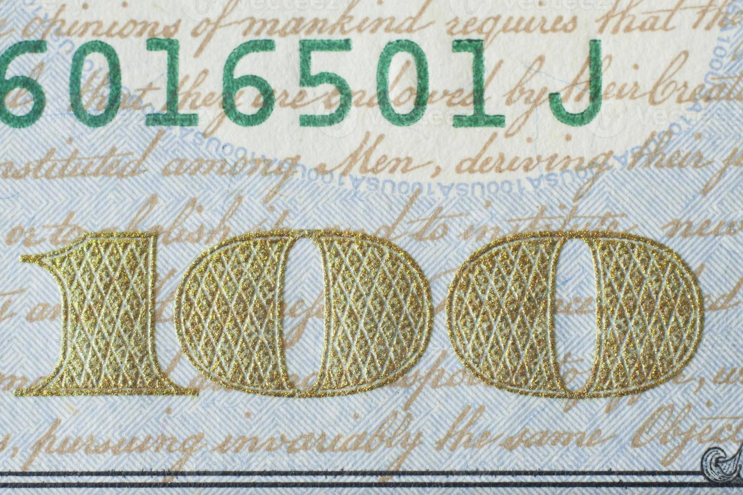 Fragment of new 100 US dollar banknote 2013 edition. photo