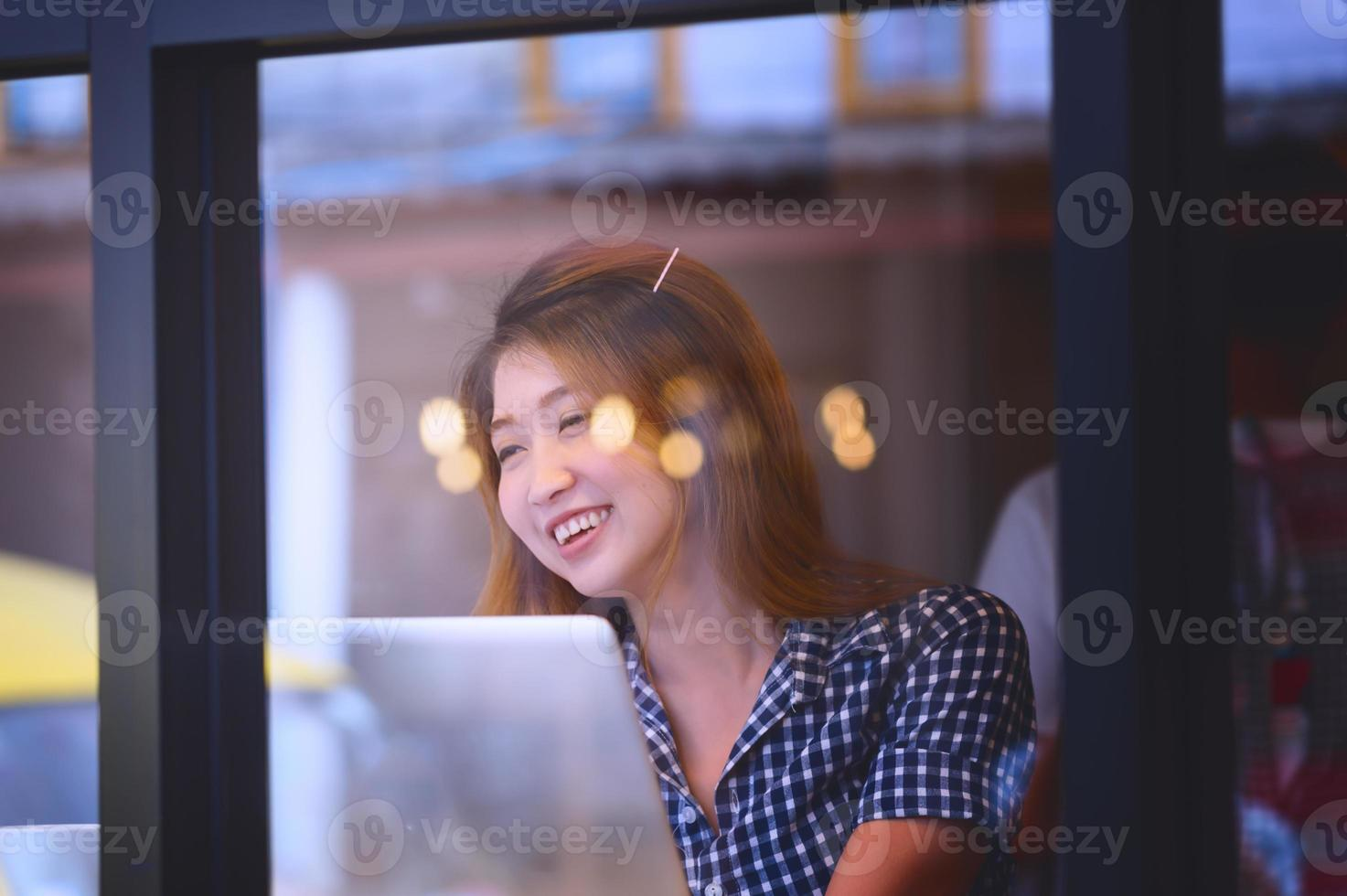 asia happy woman sitting at bar table on relax day photo