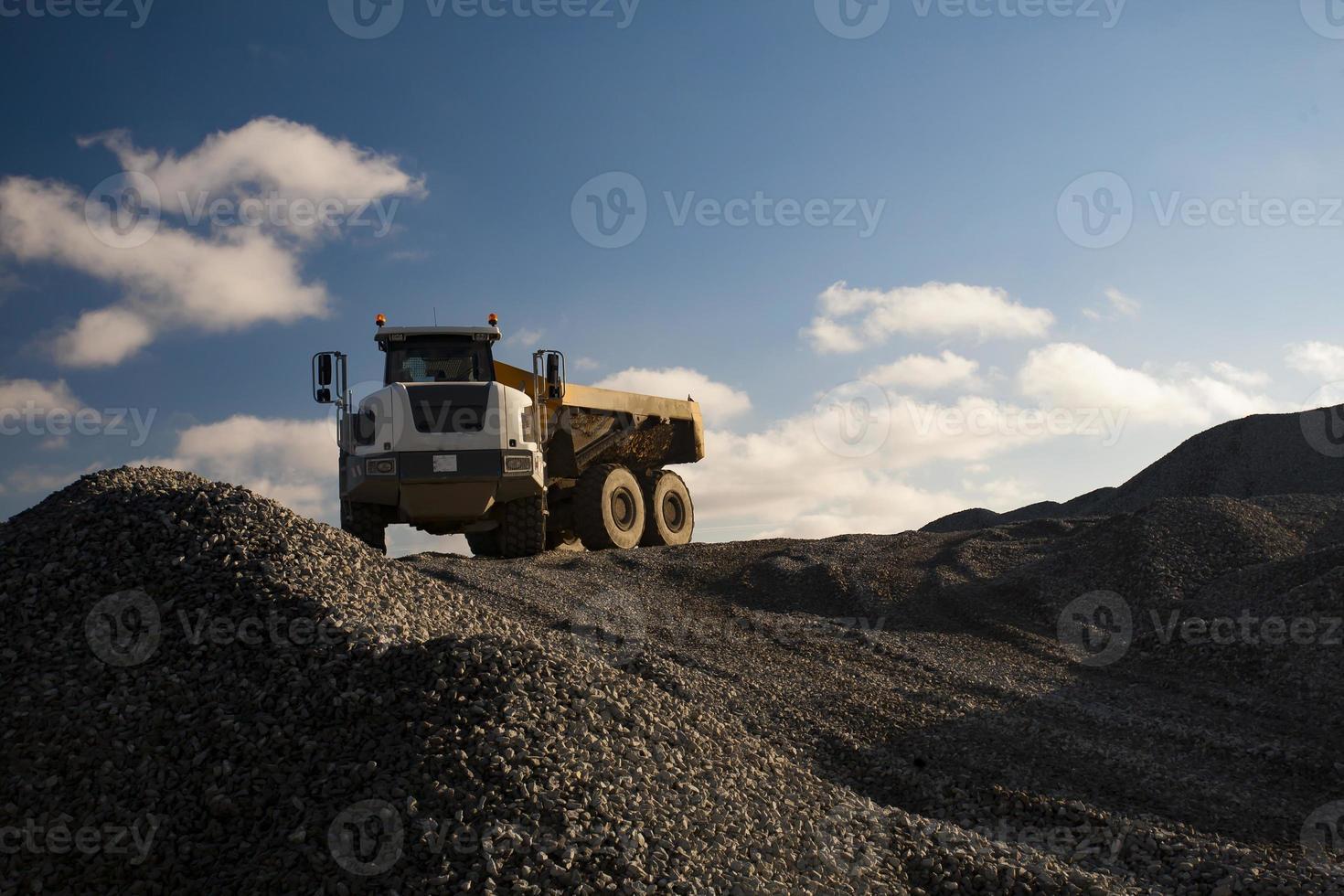 Dump Truck on the Pile of Gravel photo