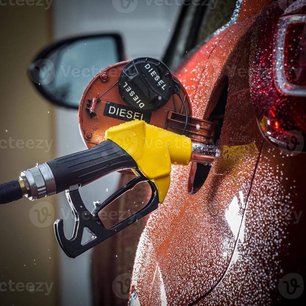 Gasoline dispenser in the car. photo