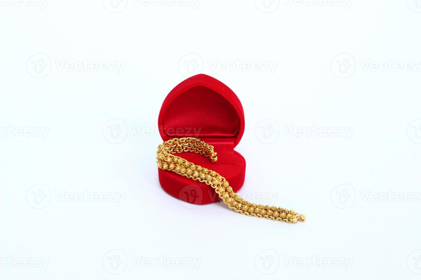 gold bracelet with red velvet box photo