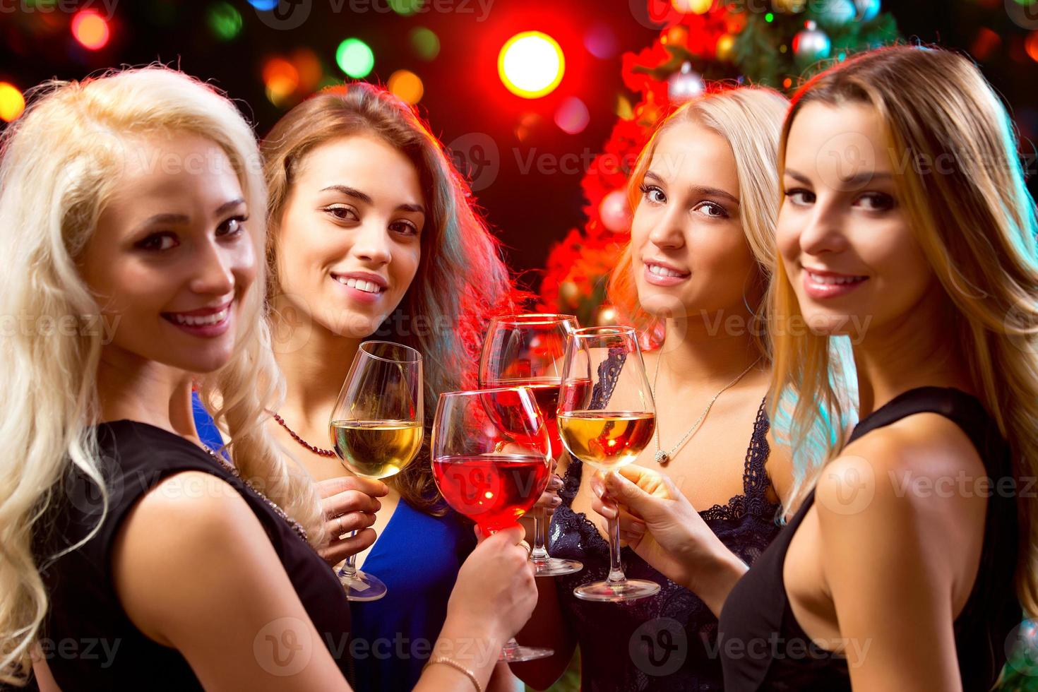 Women's hands with crystal glasses of wine photo