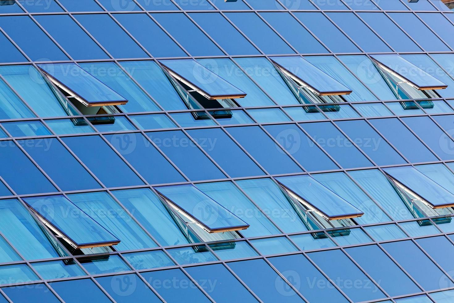 glass facade with opened windows photo