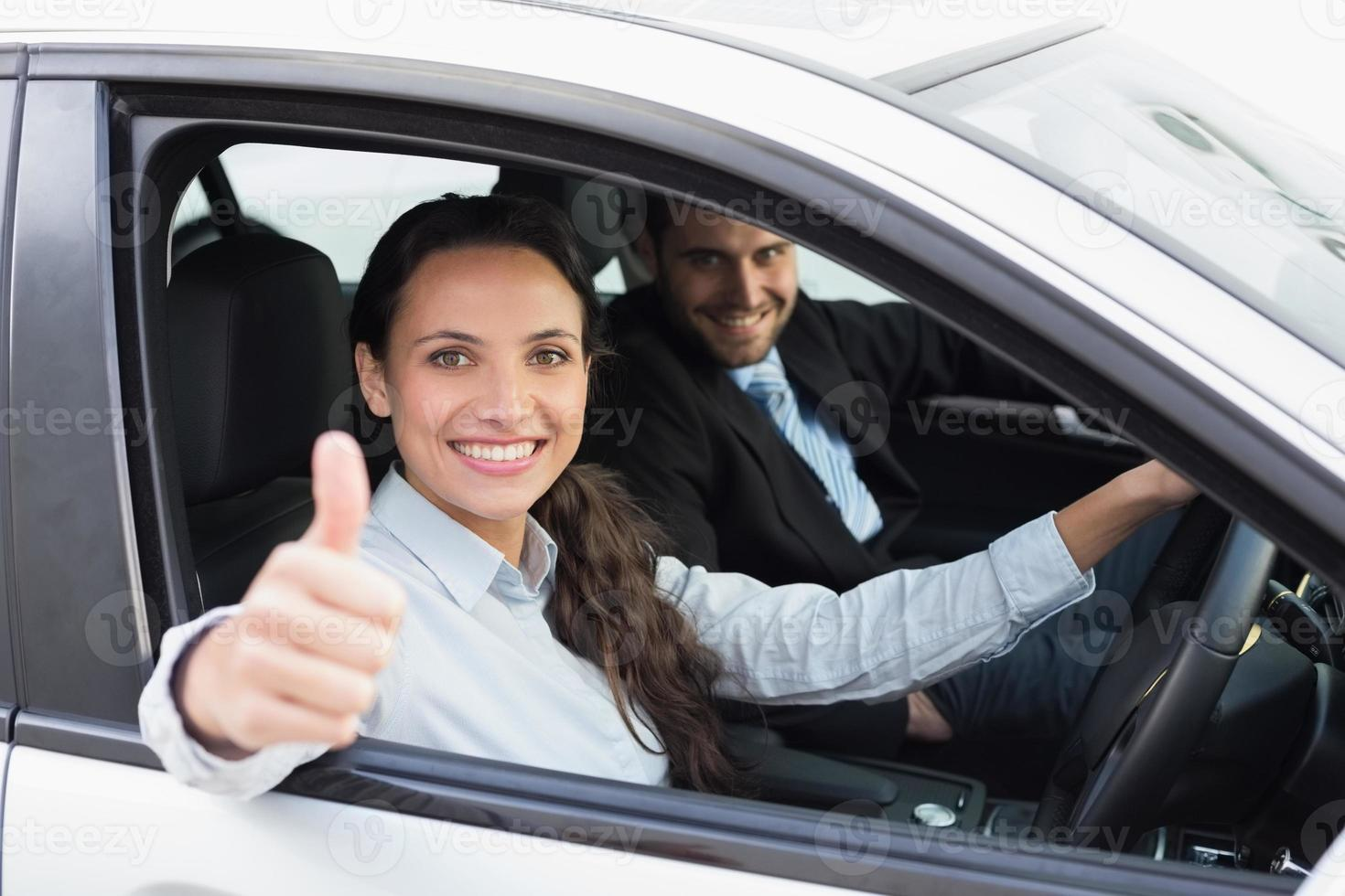 Business team smiling and driving photo