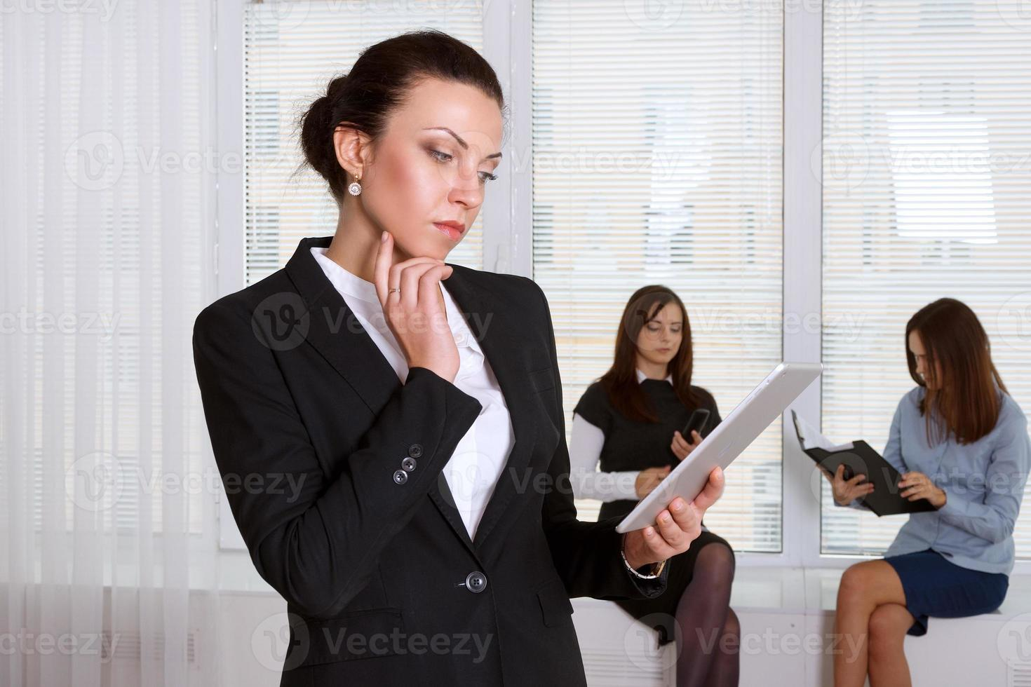 Woman in formal clothes pensively reads the information from the photo