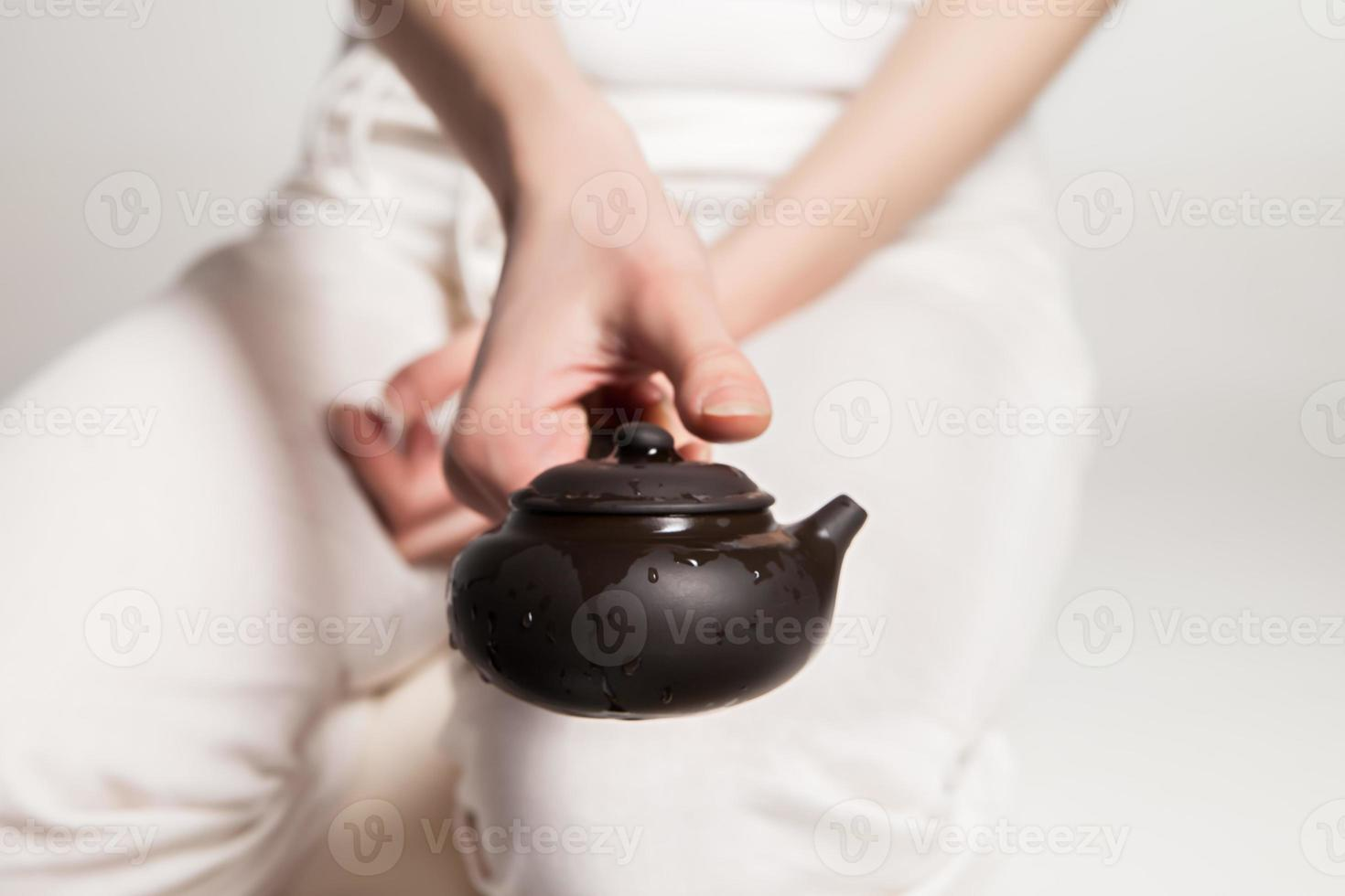 Chinese tea ceremony is perfomed by master photo