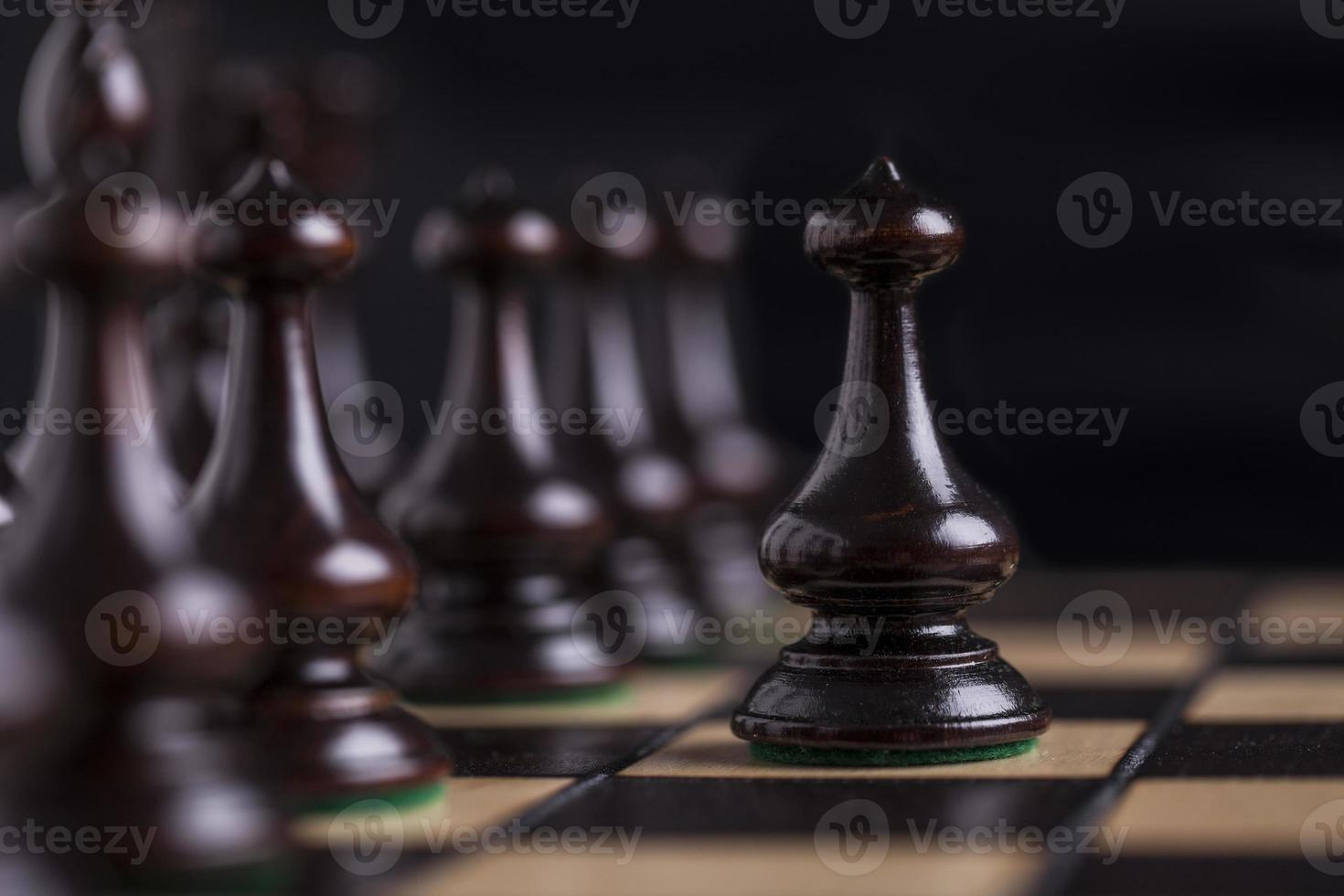 Chess pieces on a chessboard. photo