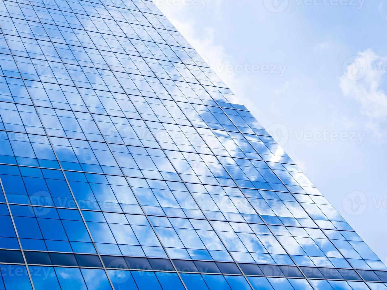 Fondo azul de rascacielos de cristal de gran altura foto