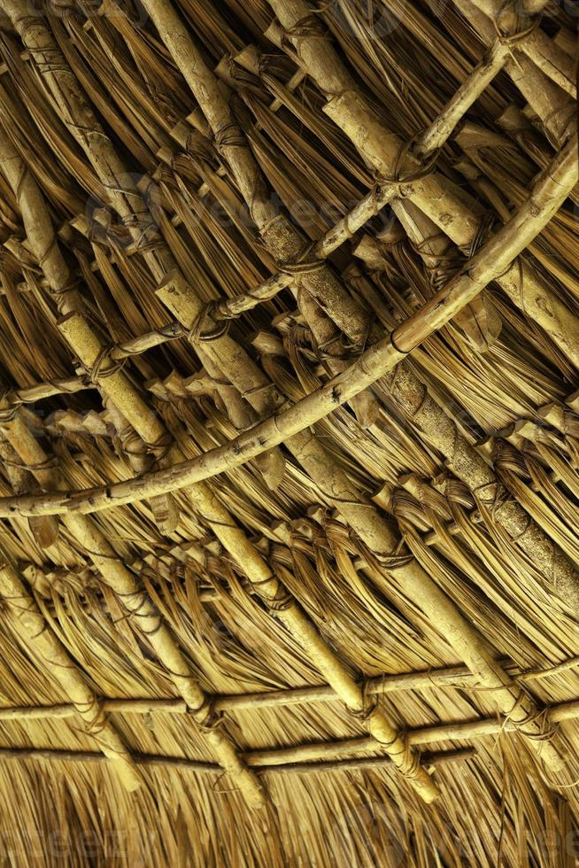 Wooden roof in a tropical native hut photo