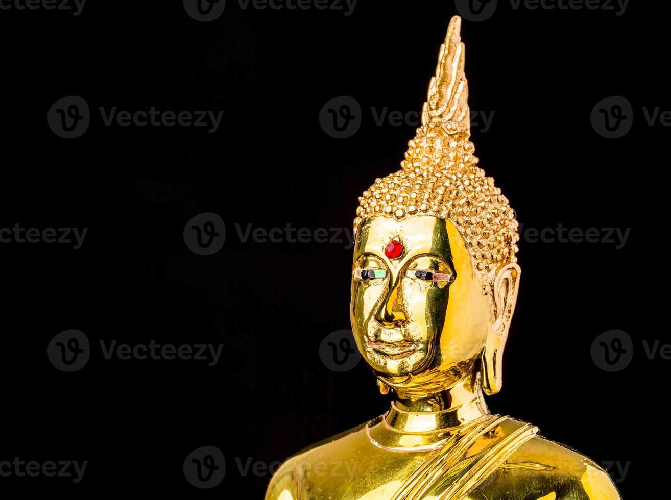 buddha statue isolated on black background photo
