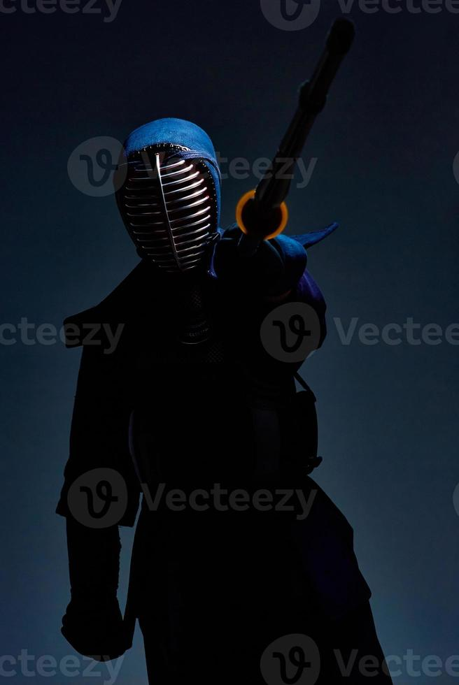 portrait of a kendo fighter with shinai photo
