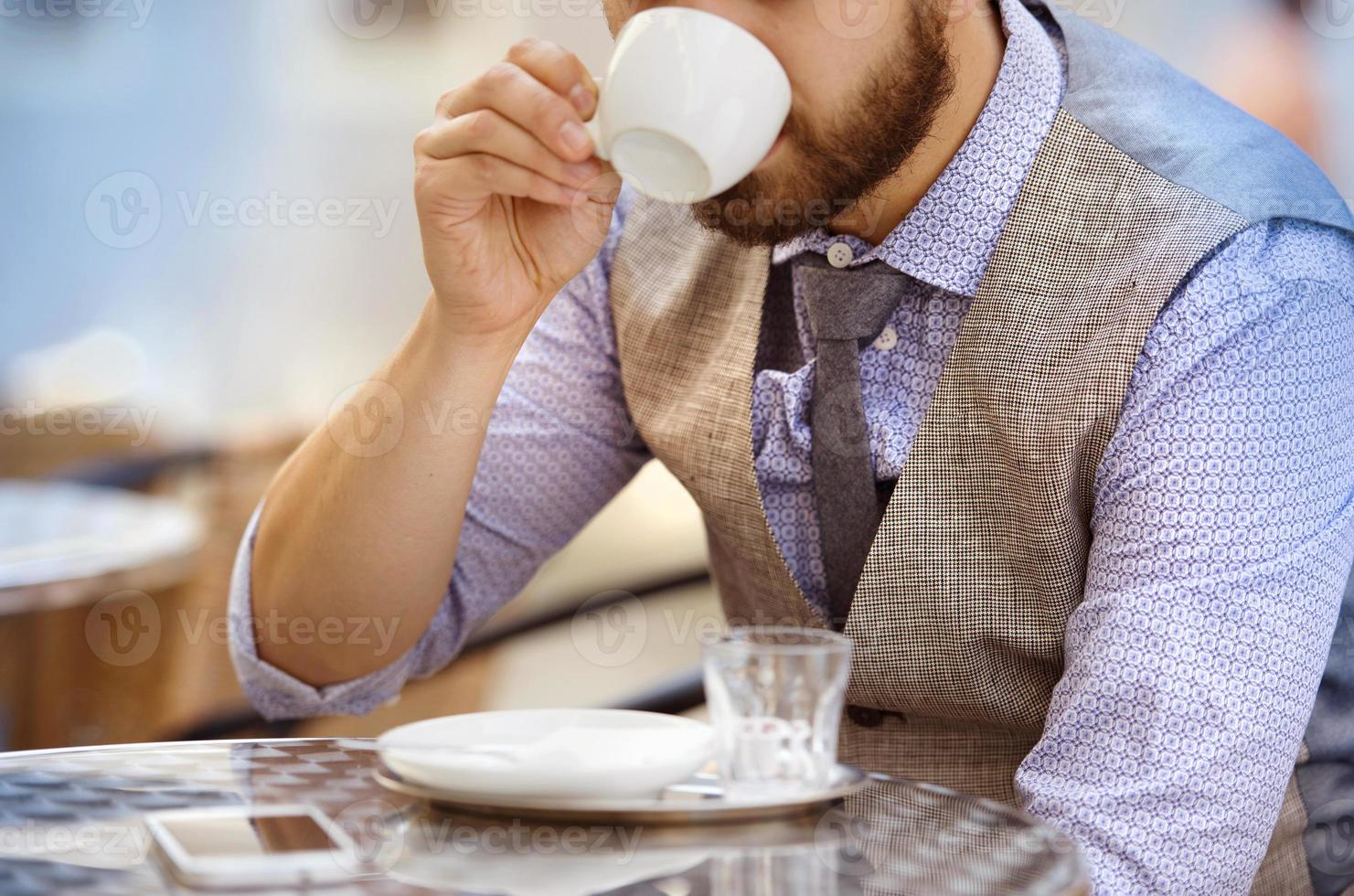 Hipster businessman in cafe photo
