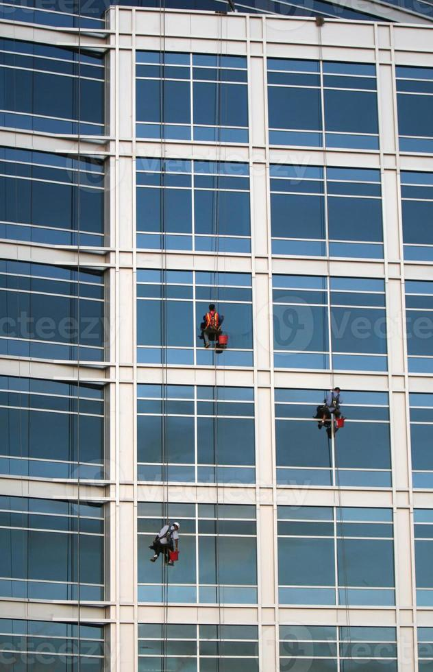Three window washers photo