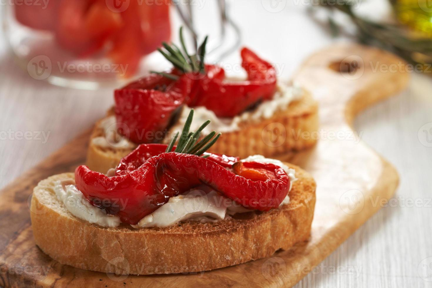 Bruschetta with grilled pepper, cheese and rosemary photo