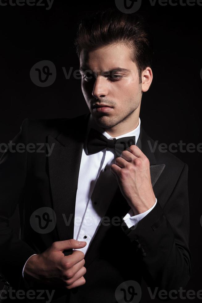 Young business man looking down photo