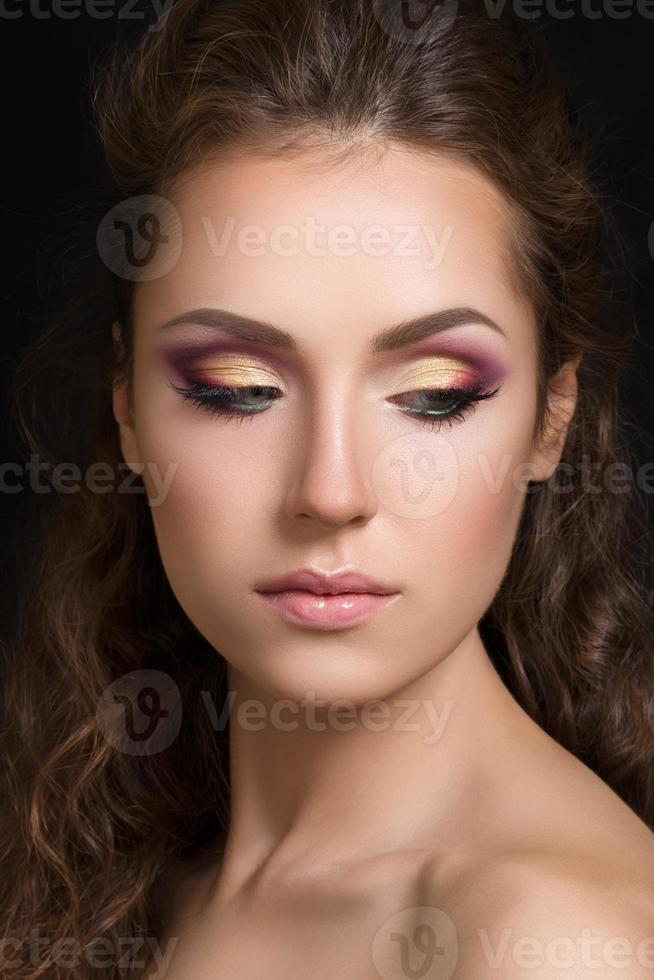 Close-up beauty portrait of young pretty brunette photo