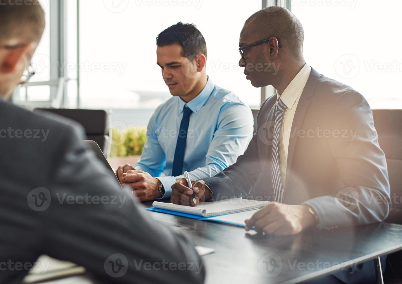 Business executives in a management meeting photo