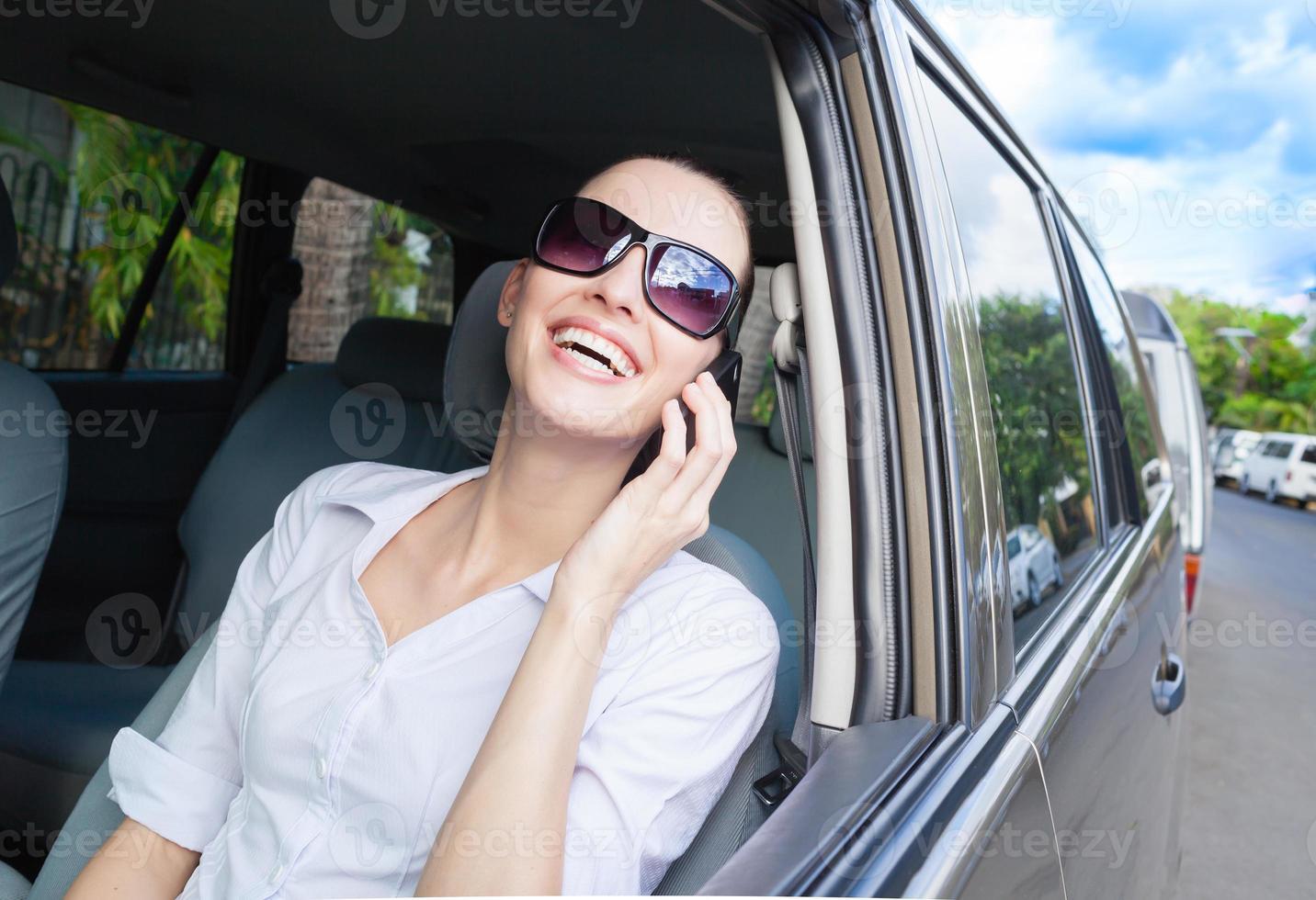 Happy woman using phone photo