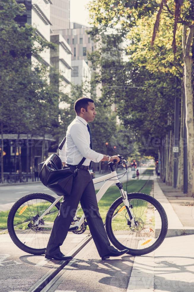 Modern businessman using bike for transportation photo