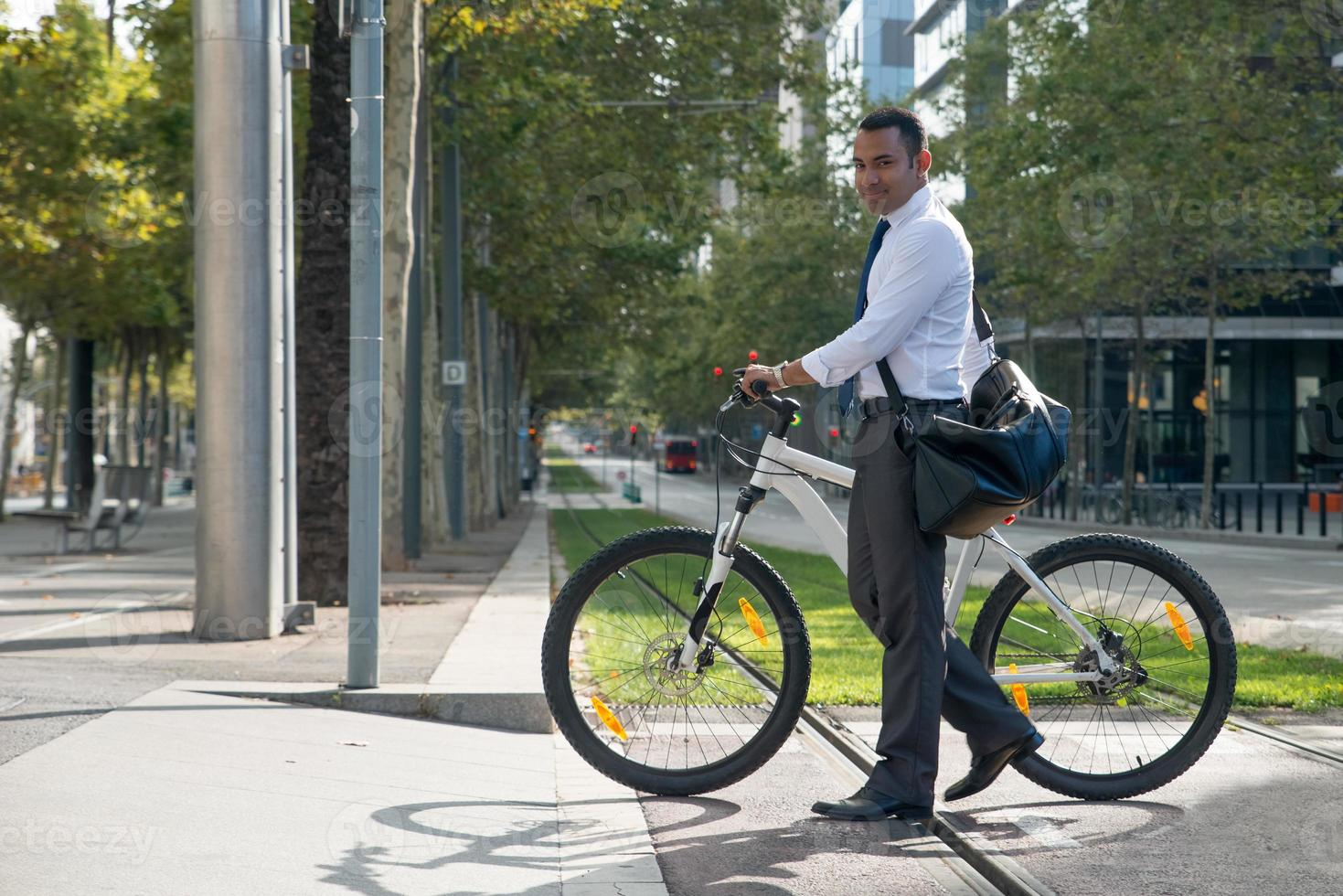 Positive active manager with bicycle going to work photo