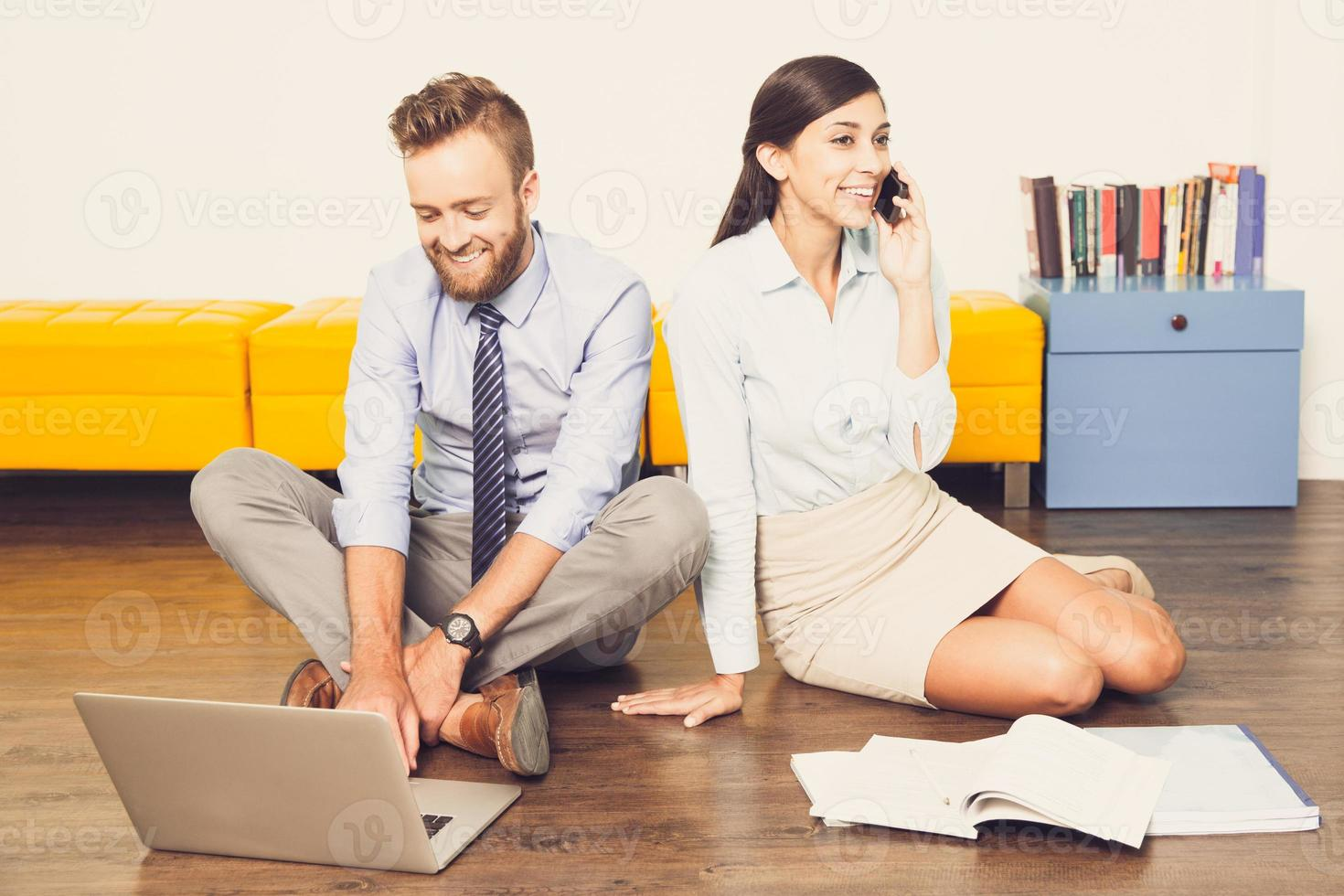 Successful managers using laptop and phone_tone photo