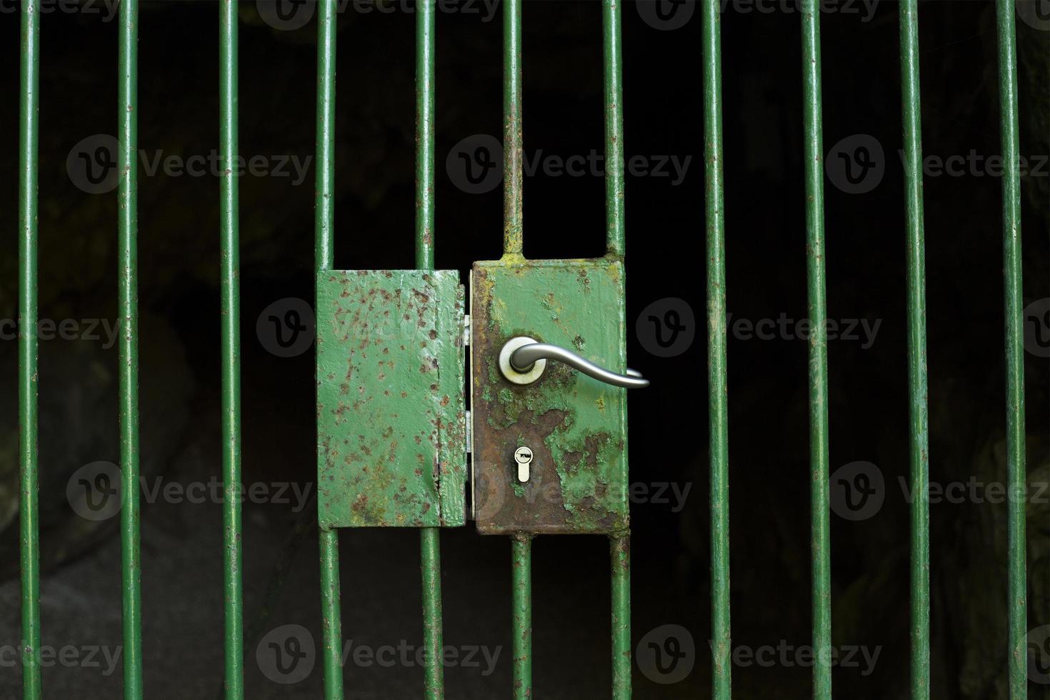 Locked cage door photo