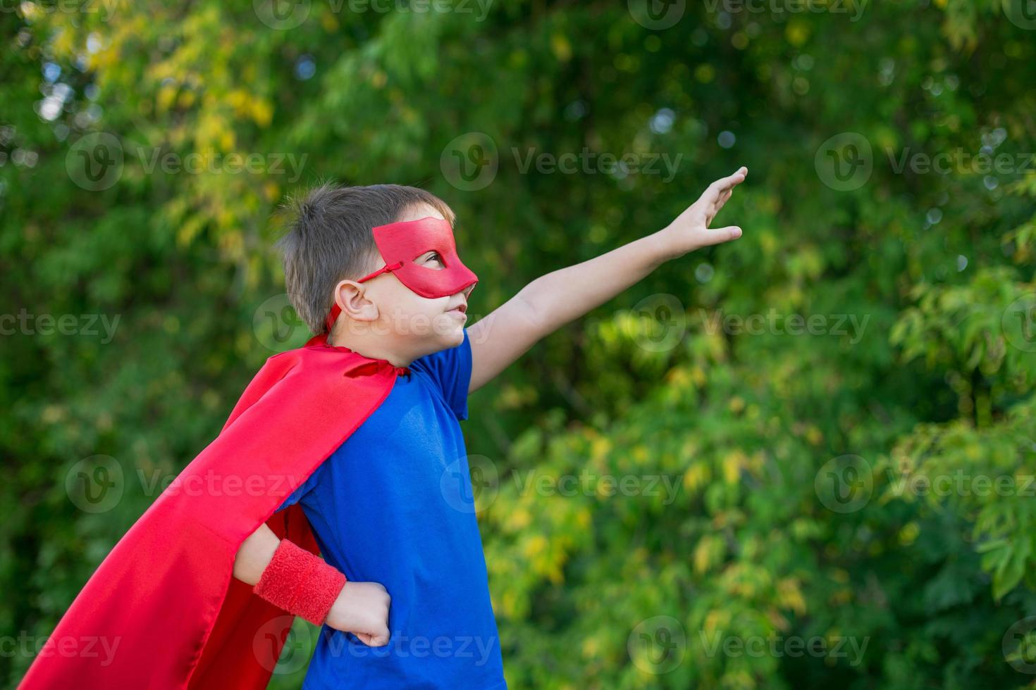 Superhero standing sideways and calling on forward photo