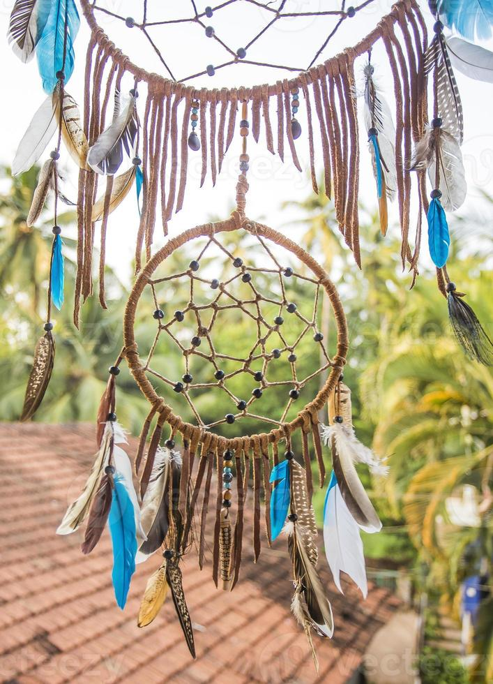 Dreamcatcher in a exotic forest. photo