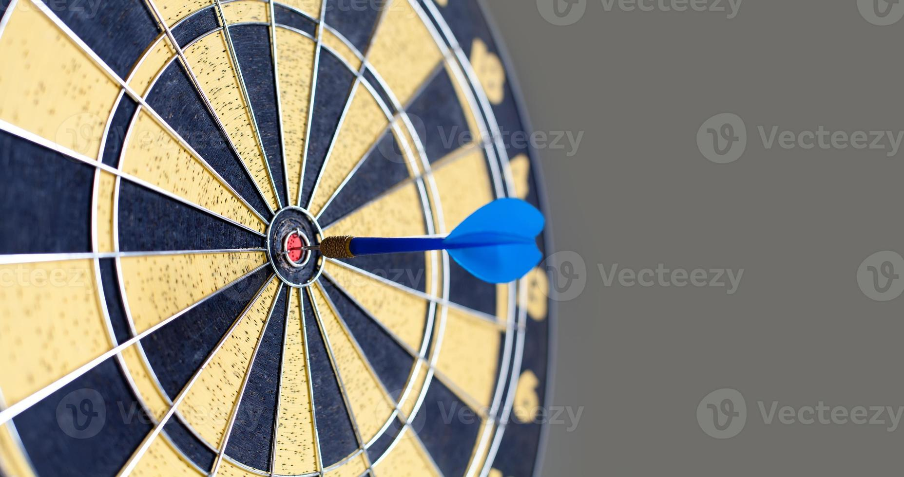 Photography of vintage yellow and black colors darts. Success hitting photo