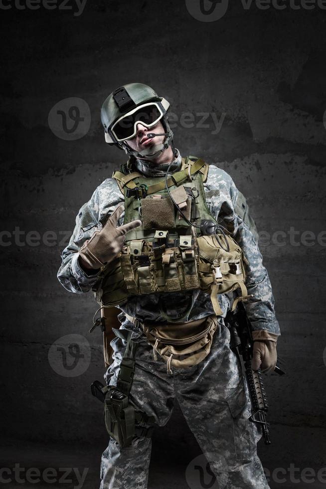 American Soldier in victory gesture photo