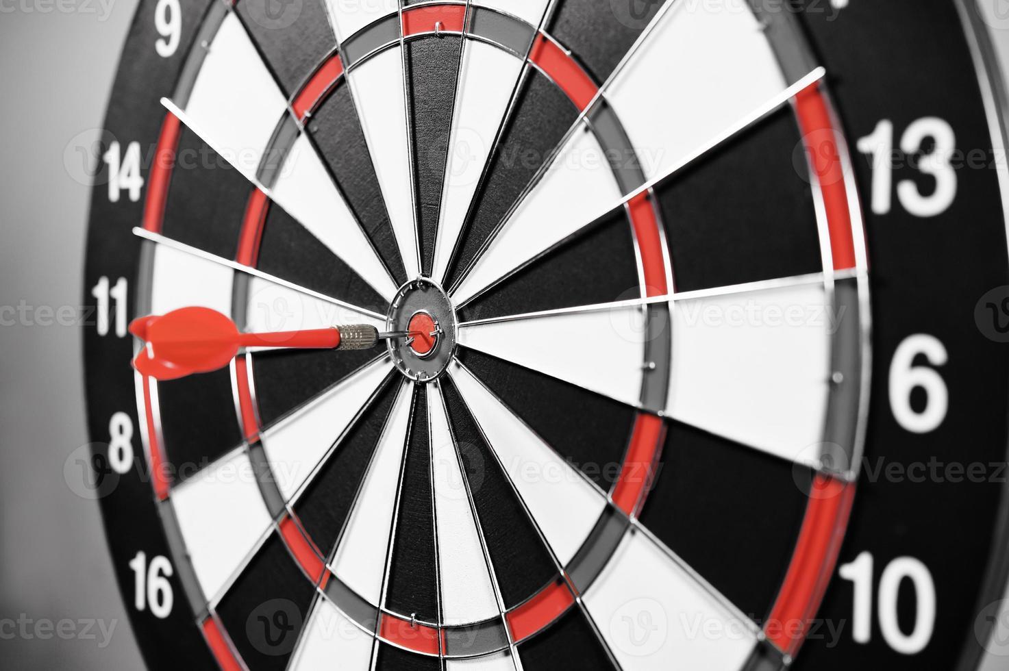 Dartboard with red darts photo