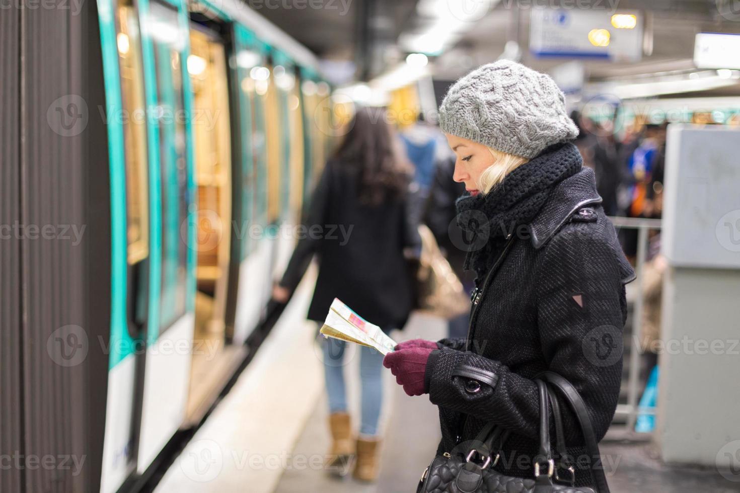 Lady waiting on subway station platform. photo
